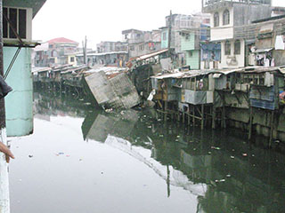 Manila slums on river